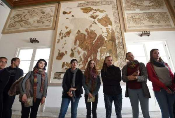 Tourists visit the national Bardo Museum in Tunis during the official re-opening of the tourist site, on March 27, 2015.  By Fethi Belaid (AFP/File)
