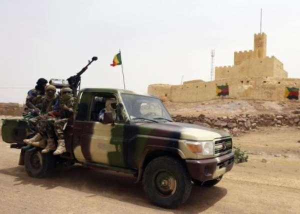 Malian soldiers patrol in Kidal on July 29, 2013.  By Kenzo Tribouillard (AFP/File)