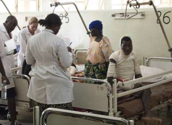 Doctors tend to patients in Mulago hospital in Kampala, on January 4, 2012.  By Michele Sibiloni (AFP/File)