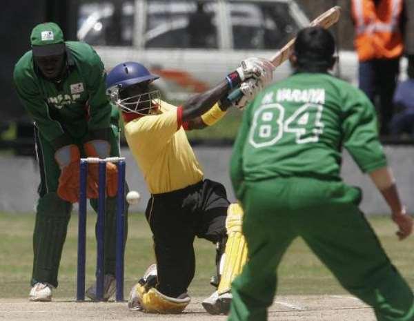 Uganda batsmen Joel Olweny misses a shot as Kenya bowler Hiren Varaiya (right) looks on during a Twenty 20 match at the Nairobi Gymkhana on  September 2, 2007.  By Simon Maina (AFP)