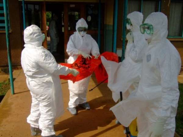 Kampala residents are striving to follow advice to avoid touching during the ebola outbreak.  By Isaac Kasamani (AFP)
