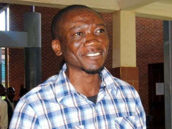 Prominent Zambian gay rights activist Paul Kasonkomona (C) leaves the Lusaka magistrate court on April 11, 2013.  By Joseph Mwenda (AFP/File)