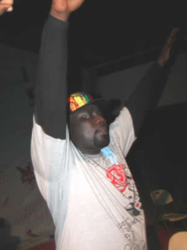 DJ Black punches the air to roars of support from his fans at a recent show