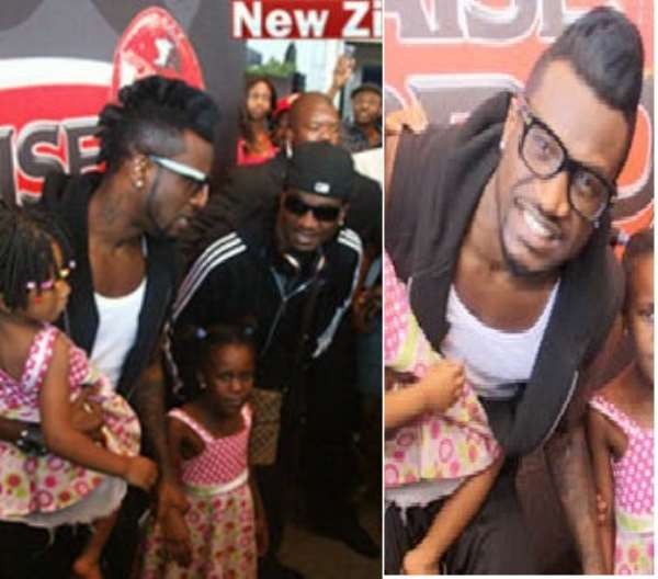 Peter Okoye Of P-Square Changes Look, Mobbed By Zimbabwean Fans