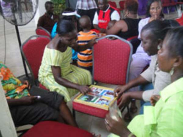 Some member of the congregation playing Ludo