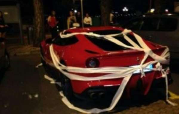 Balotelli's expensive Farrari nicely wrapped in toilet paper