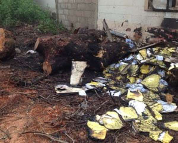 Partially burnt medical records of patients scattered on the scene after the fire which burnt the Diabetic Centre at the Korle Bu Teaching Hospital yesterday