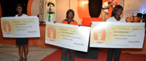 The bank's staff display cheques for the winners