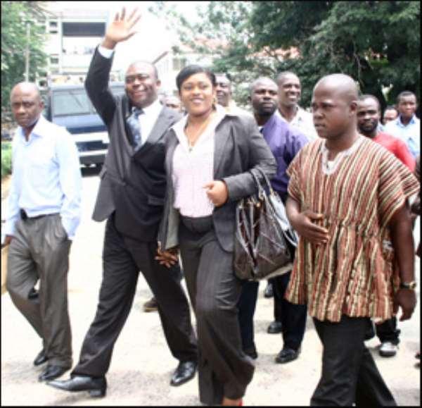 Asamoah-Boateng and wife, Zuleika waving to the crowd