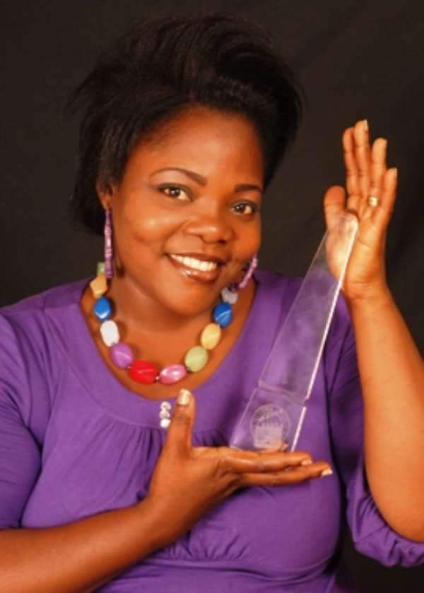 Celestine Donkor showing off her Best Gospel Music Video award she won at the 2010 4syte Music Video Awards