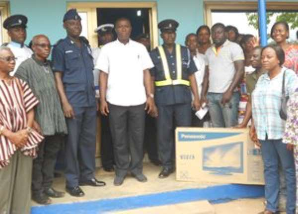 Patrick Yaw Boamah with some Officers at the Tesano District Police