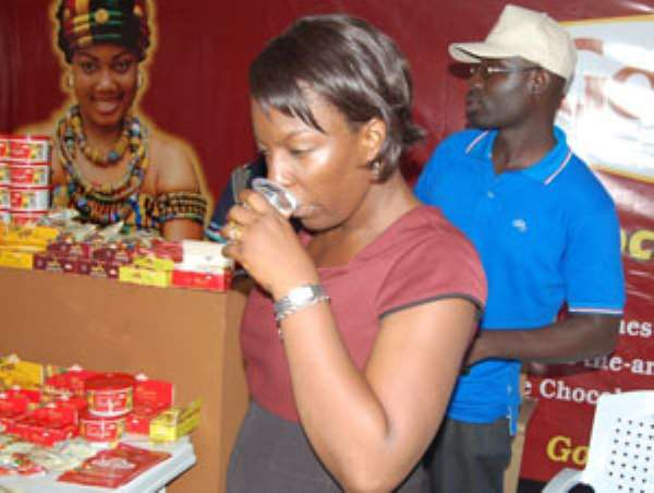 A woman consuming some refreshing chocolate drink