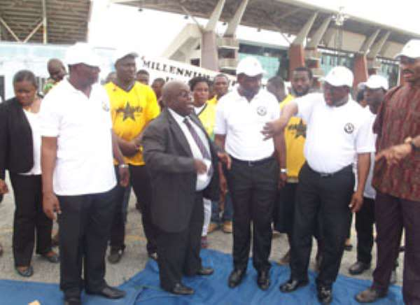 Wolanyo Agra (in suit) explaining a point to the sports minister and his entourage at the Accra Stadium