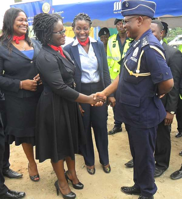 Director General COP John Kudor in a handshake with Sika Dove.