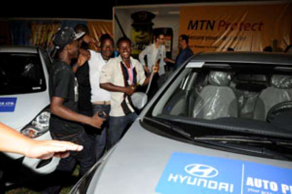 Azuberi(3rdL) with friends having a feel of his new Hyundai ride