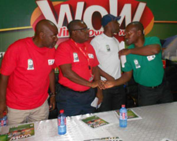 Philip Sowah (second from right) in a hand shake with Kplorlali Shine Gbologa after the launch