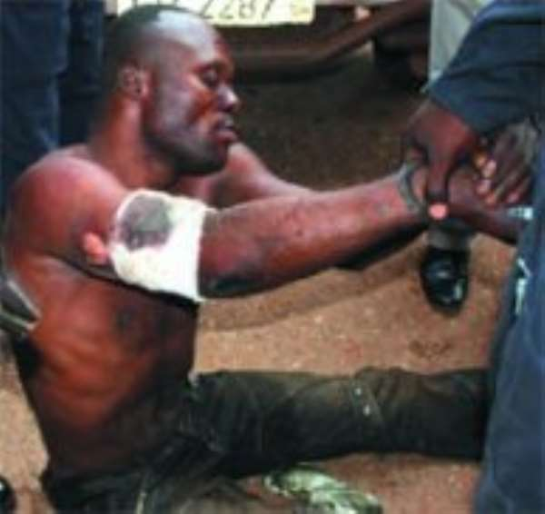 Subdued Johnson Kombian after his arrest