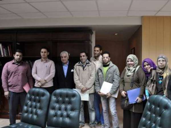 Dr. Zahi Hawass with students after a meeting