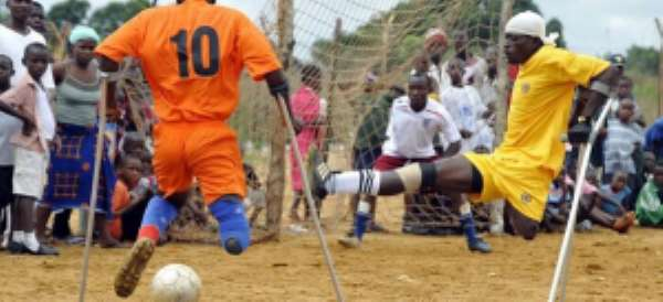 Essien Tweeted this picture of amputees playing for peace