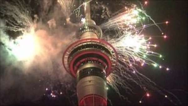 Fireworks lit up the 328m-tall Sky Tower in New Zealand's biggest city, Auckland