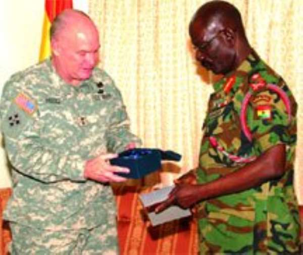 Gen. David Hagg, the United States Commander in charge of Africa  (left), admiring a gift presented to him by Lt. Gen. Augustine Blay, Ghana's  Chief of Defence Staff (CDS), at the Burma Camp in Accra.