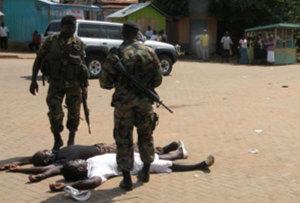 Soldiers drilling suspected criminals at Ho