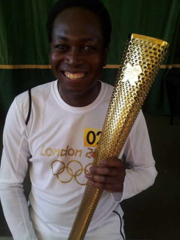 Former GNA staff Hutchful takes part in Olympic torch relay