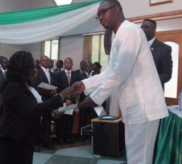 One of the forest prosecutors receiving her certificate from Mr. Samuel Afari Dartey.