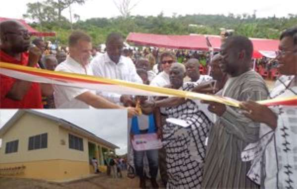Top dignitaries cutting tape to open the project. INSET: The health facility