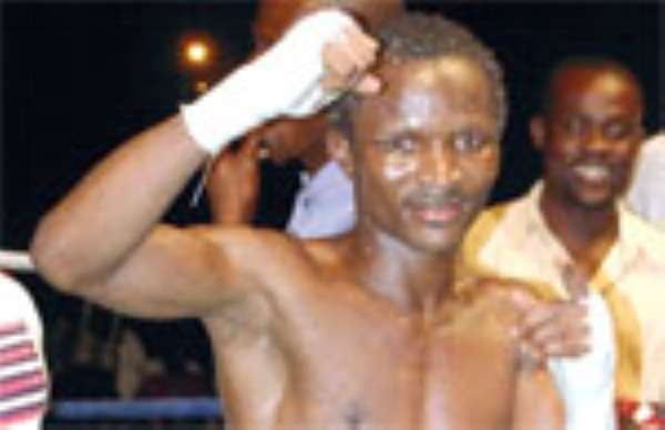 Robbers Attack Agbeko's Trainer