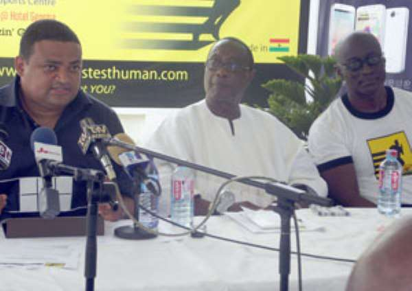 Yammin (L) delivering his address at the function. With him are Mike Gizo and Brobby