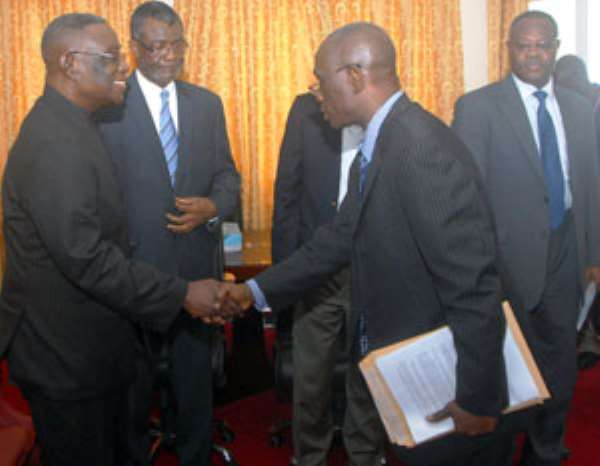 President Mills receiving the damning EOCO report from Mortey Akpadzi while Chief of Staff, Henry Martey Newman looks on