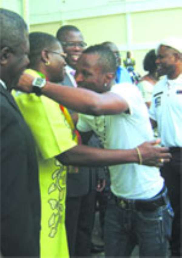 Akua Sena Dansua gives the Champ a welcome hug on his arrivial. Looking on is Mr. Kwetey