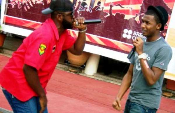 Two rap artistes doing their thing on stage