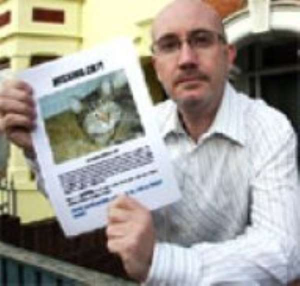 Mike Harding designed 20 posters in a last appeal to neighbours after seven-year-old Tabby cat Wookie disappeared.