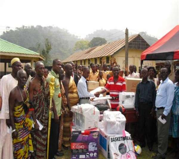 Mr. Asamoah in red made the donation to Mr. Asirifi MCE of Kibi