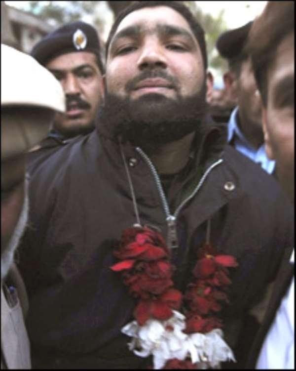 Killer Qadri Garlanded