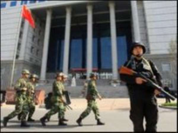 China sentences five to death over riots