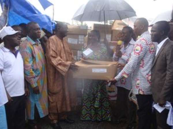 Minister of Health, Hon Sherry Ayittey receiving the essential drugs donated by PSGH from James Ohemeng Kyei