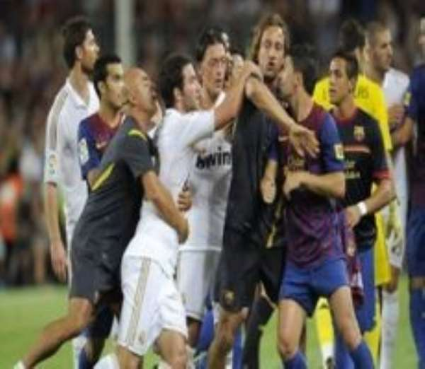 Barc and Real players square up against each other during a recent El Clásico