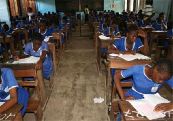 Student writing their B.E.CE. exams