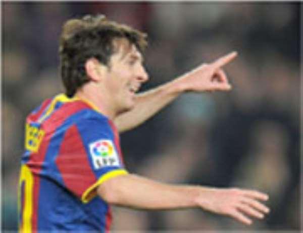 Messi, celebrates one of his hat-tricks