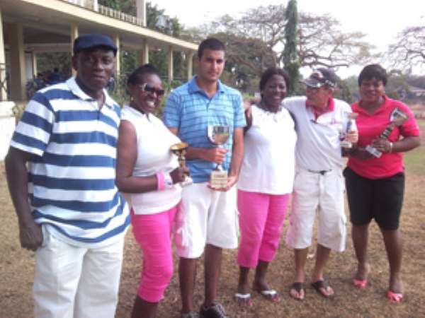 Martin Poku, captain of the Royal Golf Club, in a group photograph with the winners.