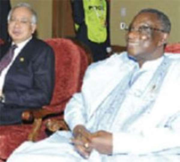 President Mills with colleague, the Malaysian Prime Minister, Najib Abdul Razak, at one of the retreat sessions.