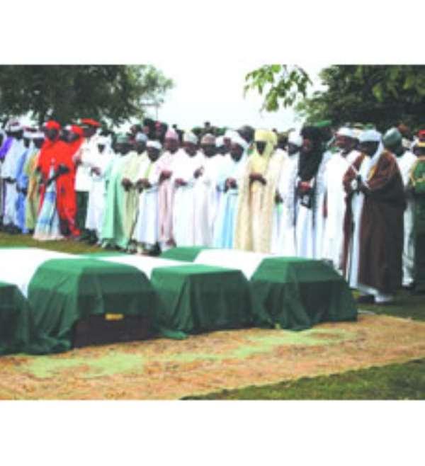 Muslim clerics praying for the deceased