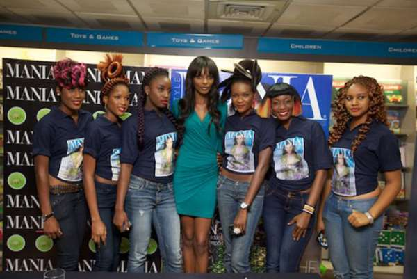 Agbani Darego chic in green at Mania Magazine signing in Lagos
