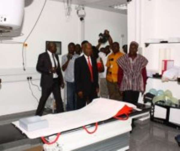 Mr Alban Bagbin (in smock) being taken round some of the facilities at the Sweden Ghana Medical Centre.