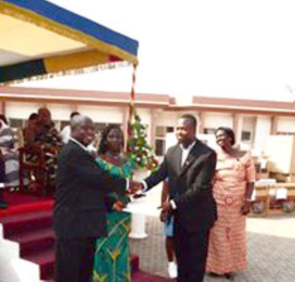 One of the award winners receiving his certificate of honour