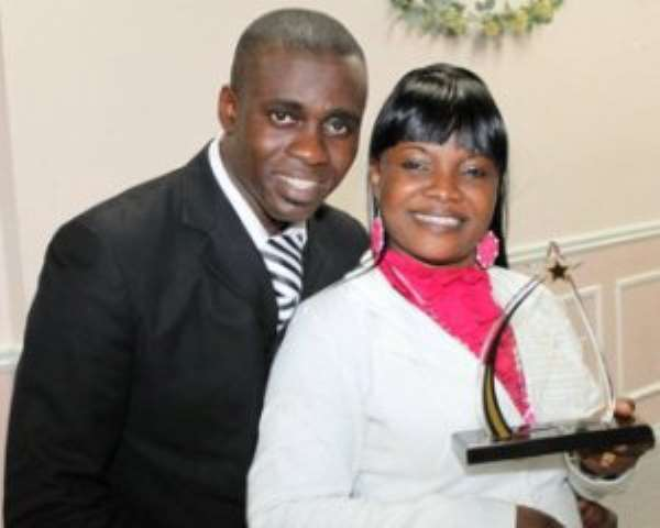 Ohemaa Mercy (holding award) with husband and manager, Isaac Twum-Ampofo.
