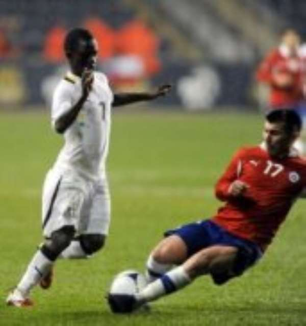Ghana's Richard Mpong steals the ball from Chile's Gary Medel. Photo credit: AP